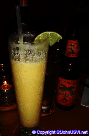 Mixed drink and a Virgin Islands Mango Ale