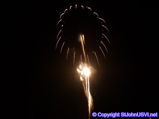 Gold circle with fireworks shooting up